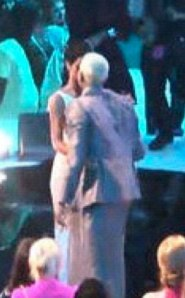 Rihanna and Chris Brown share a kiss at the VMAs