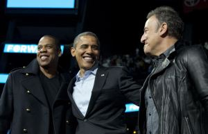 President Barack Obama is flanked on stage by musicians Jay-Z, left, and Bruce Springsteen at a campaign event at Nationwide Arena, Monday, Nov. 5, 2012