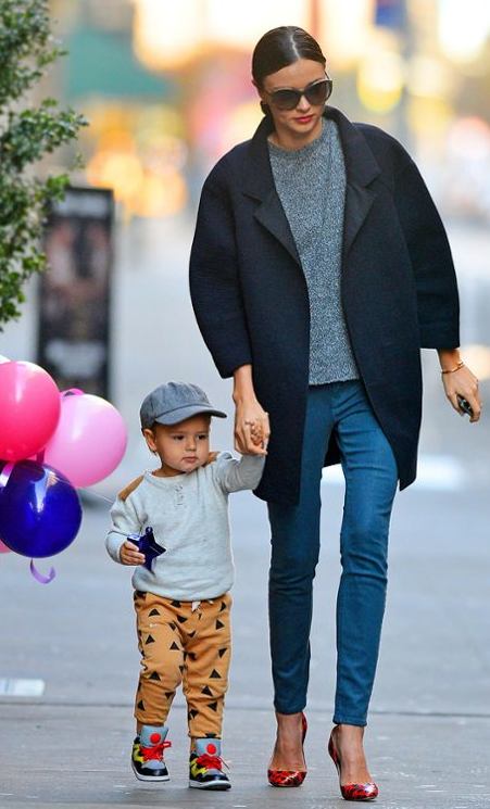 The supermodel mom takes son Flynn for a Thanksgiving Day stroll.